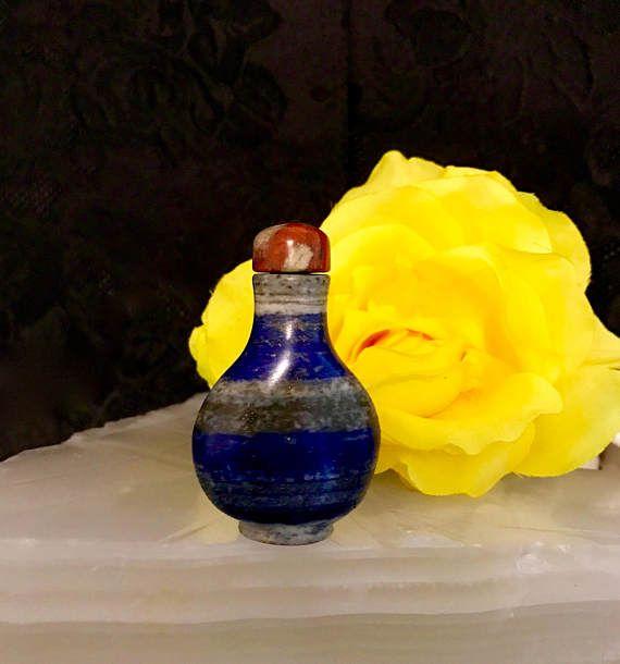 chinese lapis lazuli specks gold snuff bottle carnelian top