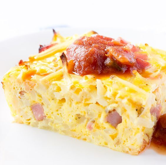 It took me longer to preheat my oven than it did for me to prepare this easy breakfast casserole. I used hash browns, cubed ham, eggs, and shredded cheese.