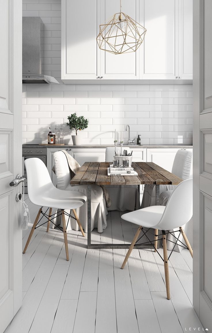 Whats not to love about this dining roomkitchen combo theres a a golden cobweb chandelier sits over a beachy wooden table white chairs join the party with different coloured wooden legs kitchen inspiration arubaitofo Gallery