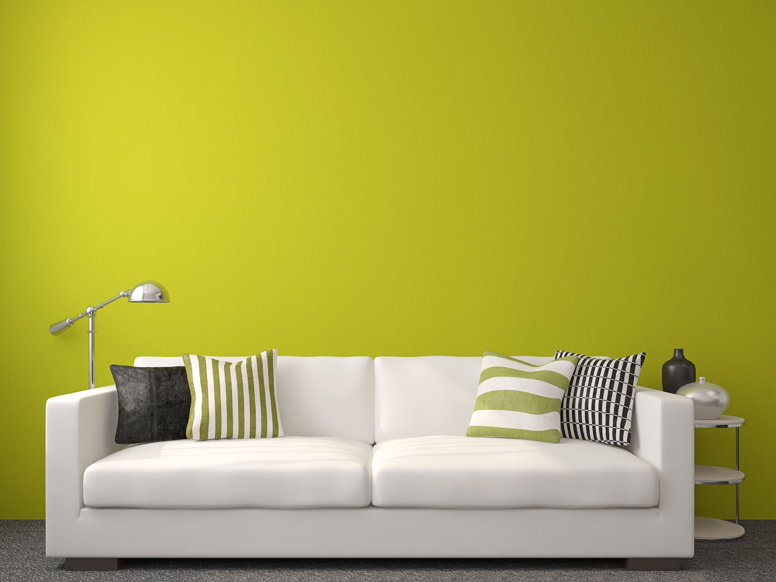 an off green, almost yellow wall that is affected by the sunlight ...