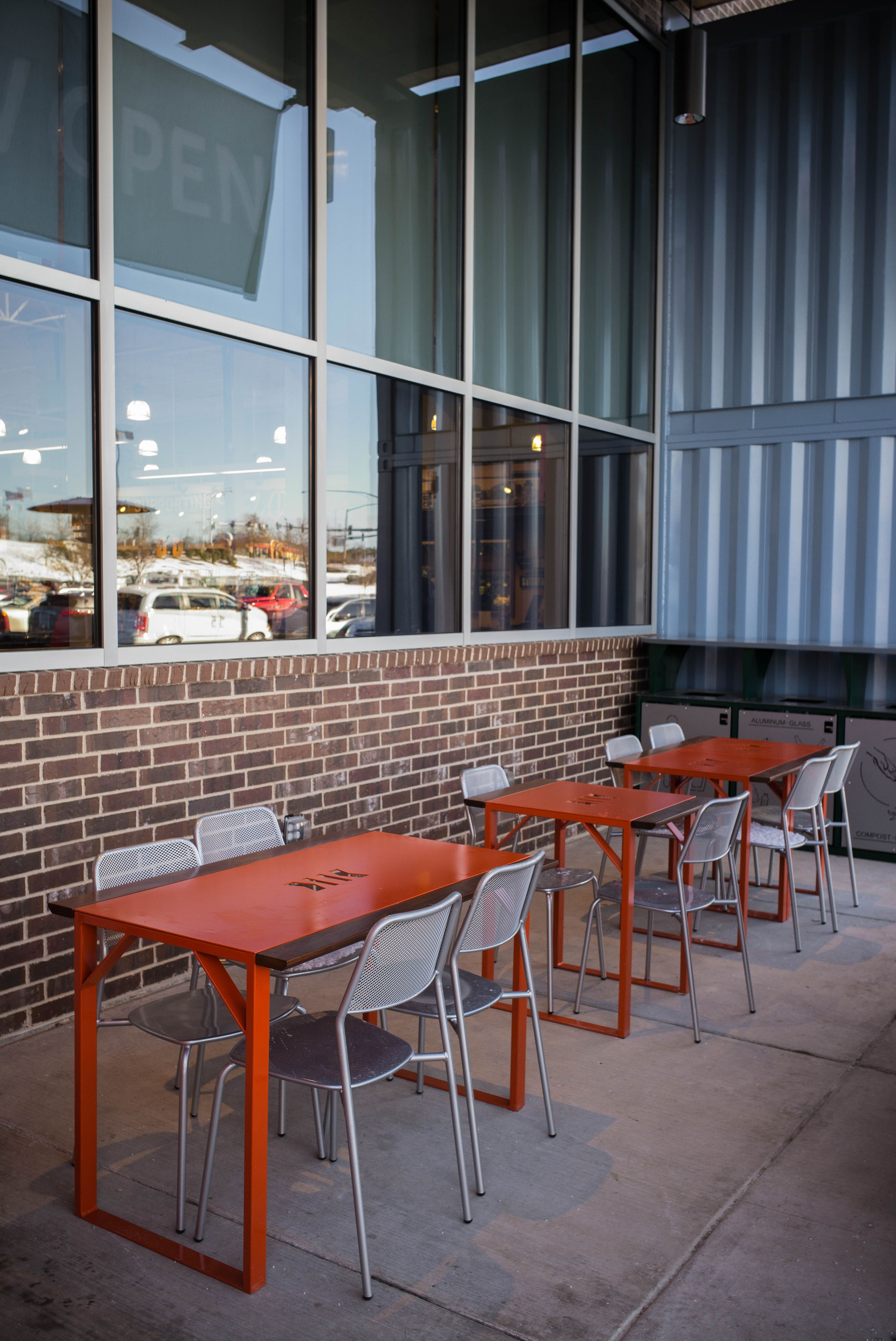 Ipe and powder coated steel exterior dining tables