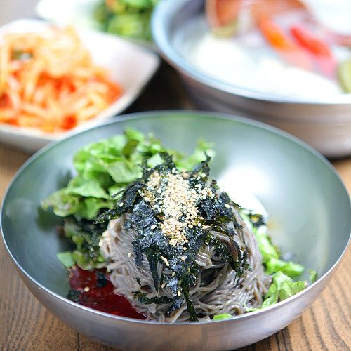 Makguksu, or buckwheat noodles served with lettuce leaves, dried nori, and spicy cho gochujang!