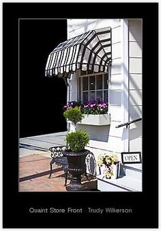 Curved Retractable Awnings Over Storefront Google Search House Awnings Quaint Store Pergola Shade