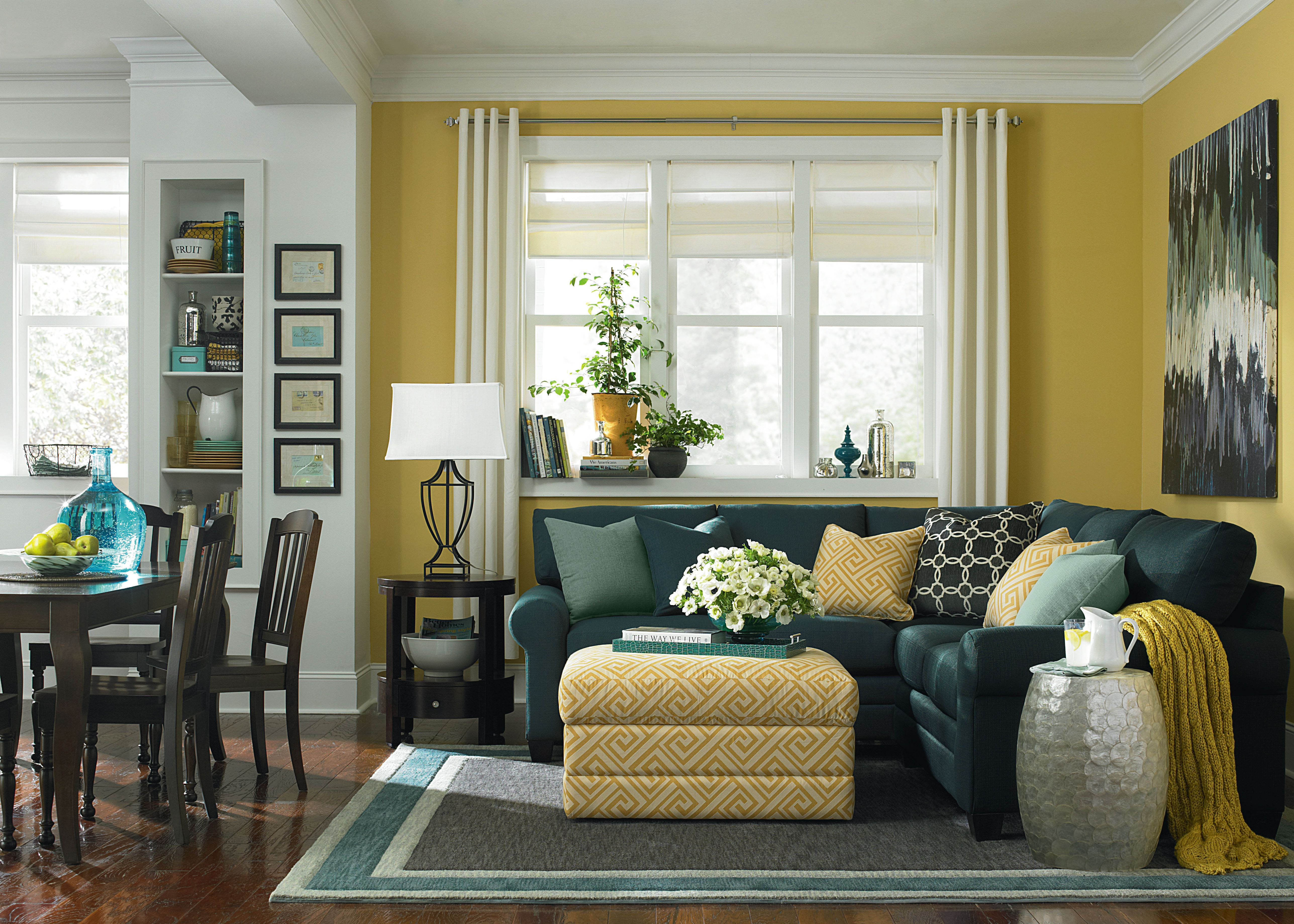 accent of yellow in the living room  l shaped living room