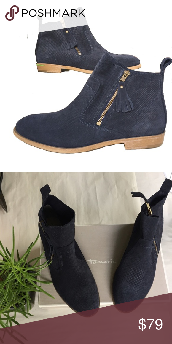"""NIB Tamaris Cigarra Navy Perforated Ankle Boot Gorgeous navy blue suede bootie from Tamaris. Soft suede upper with a rubber outsole, this is a perfect, chic boot for any occasion. Intricate perforations all over the suede upper. Lightly padded soles for comfortable wear all day. Pull tab on the back for easy on and off. Gold side zipper closure with a small blue suede tassel. Heel height is about 1"""", so not high at all. The shaft height is about 5"""" tall. (location D8) (no trades - no…"""