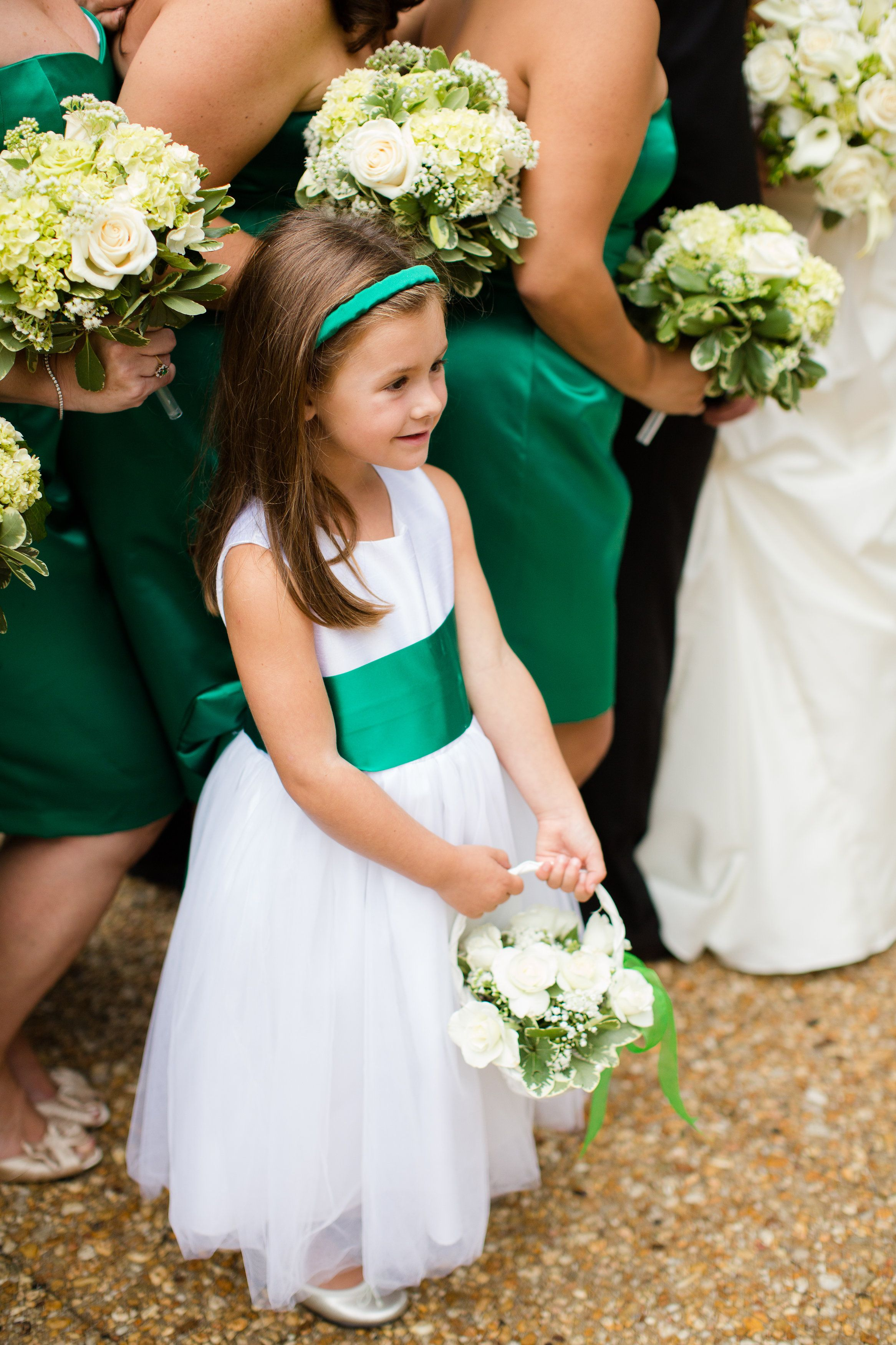 An emerald green sash for the flower girl to match the bridesmaid dresses