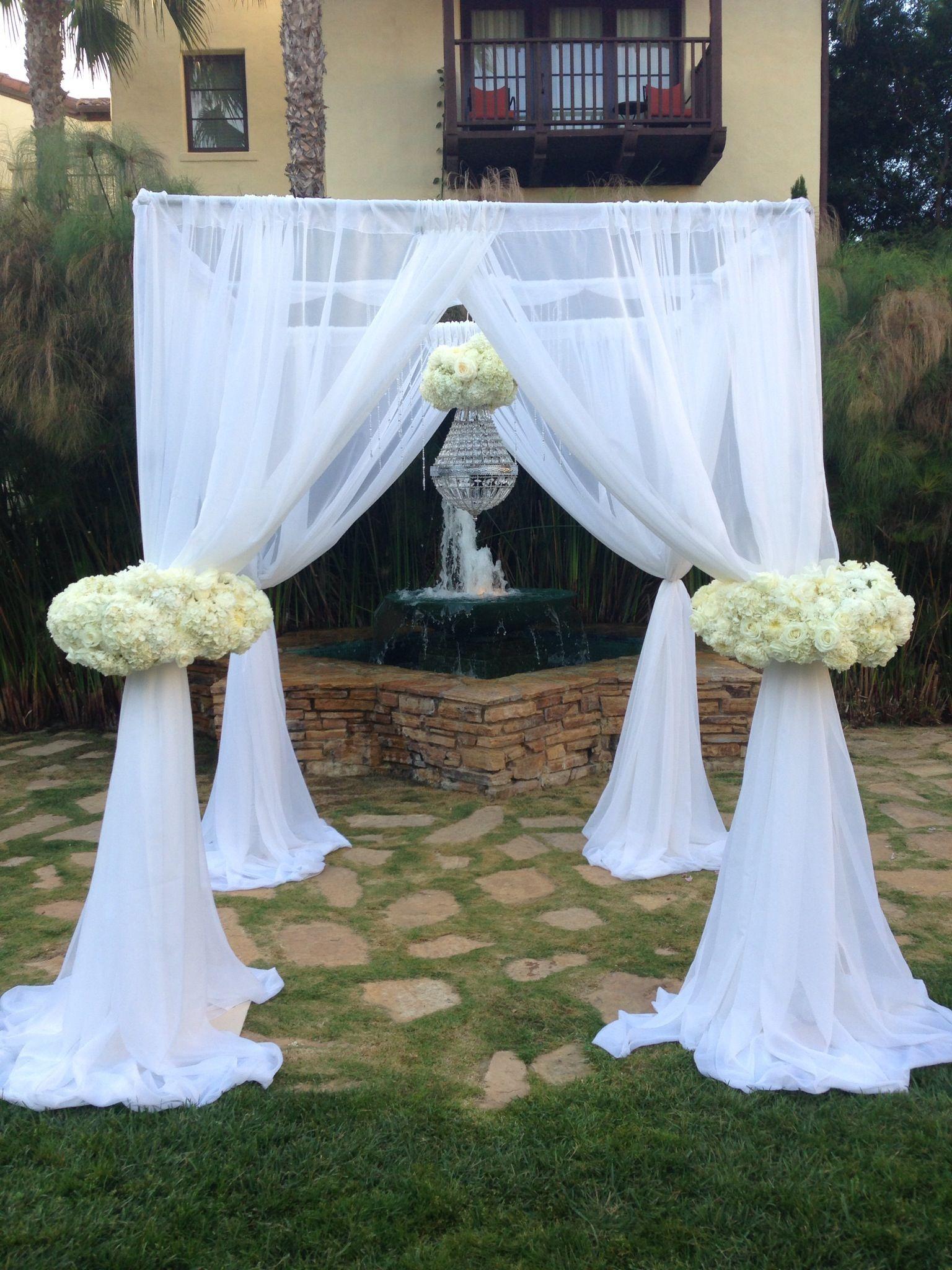 custom arch designed and built by flower box wedding arch white fabric hydrangeas