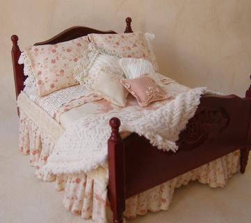 A charming 12th scale miniature bed dressed in 'shabby chic' style in a blend of soft and delicate cotton prints. The fabrics are from the Mary Rose Collection and are a stunning mixture of large and small foral designs in dusky peaches and tans on a cream background.