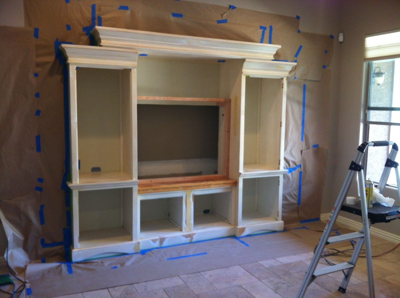 Adding a custom entertainment center to a standard drywall How to build an entertainment wall unit