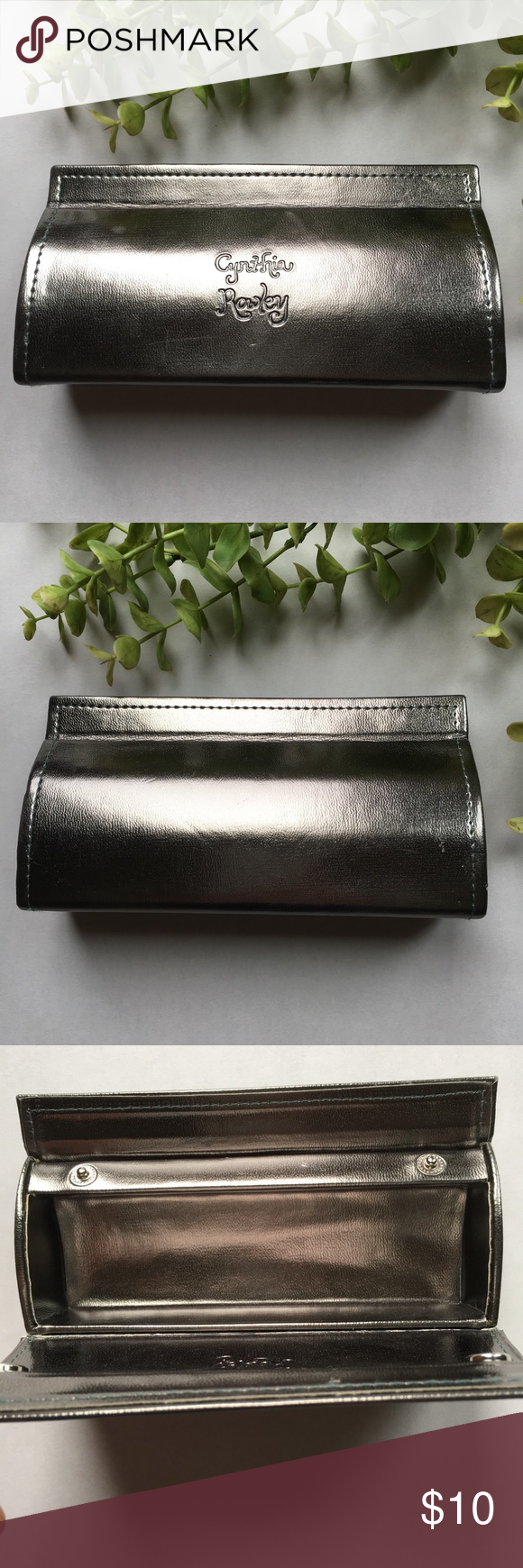 Cynthia Rowley Pewter Sunglass Case Silver / Pewter color. Markings on front. Wear at crease (shown). Length 6.25 inches. Height 3.25 inches. Please refer to pictures prior to purchase. Cynthia Rowley Accessories Glasses