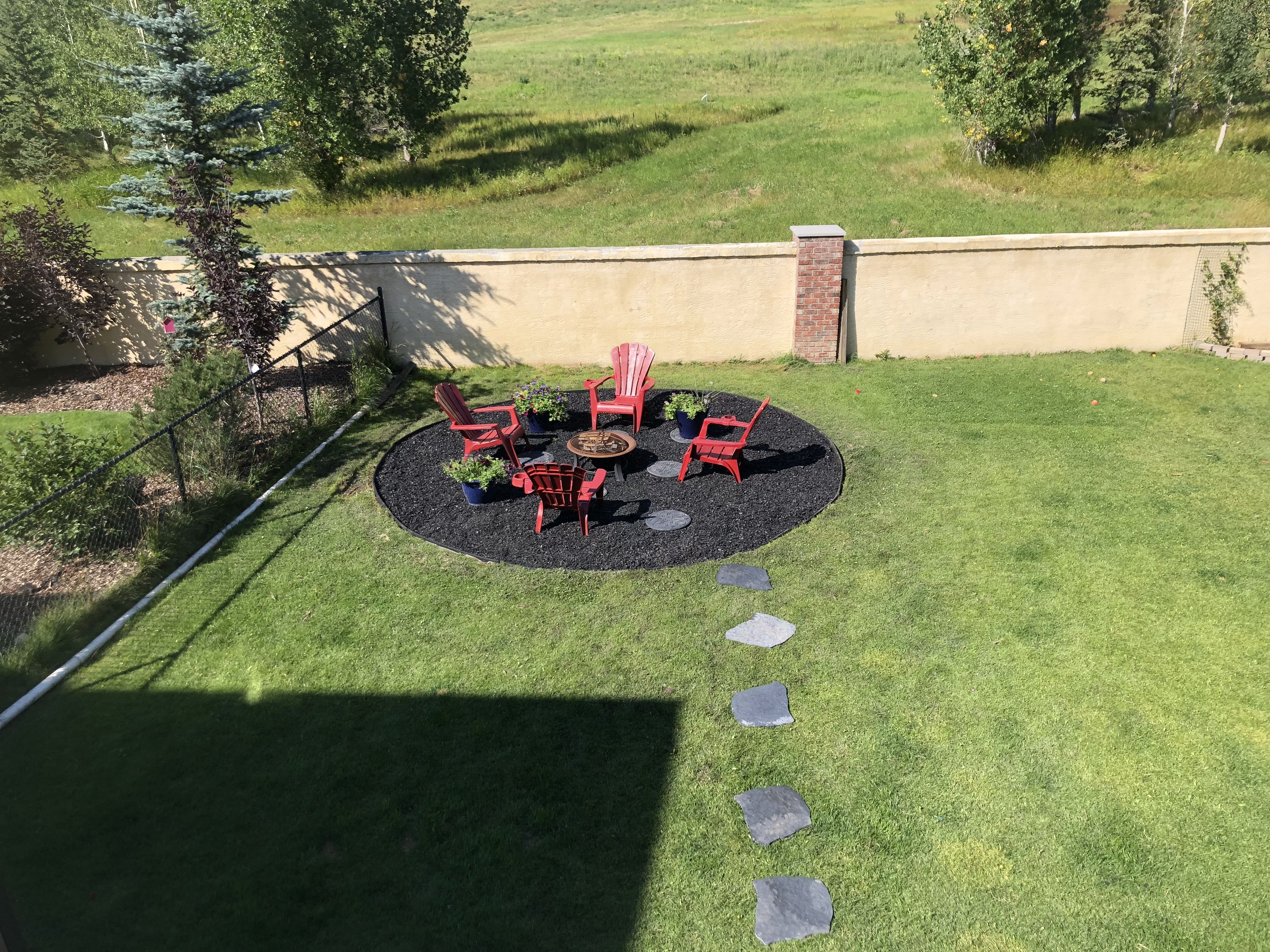 Made It With Rubber Mulch For 9 Months Of The Year It Is A Fire Pit And For Our Short Summer It Has Our Pool On It Rubber Mulch Fire Pit Backyard