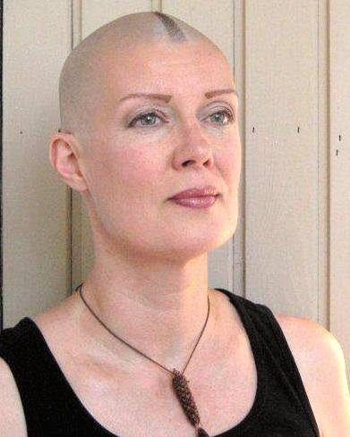 Shaved head bald female