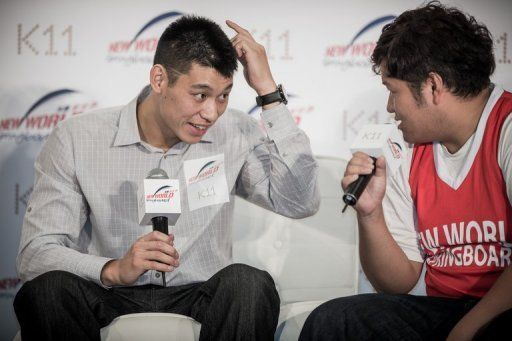 """Jeremy Lin, shown speaking with a fan in Hong Kong, called the city """"beautiful"""""""