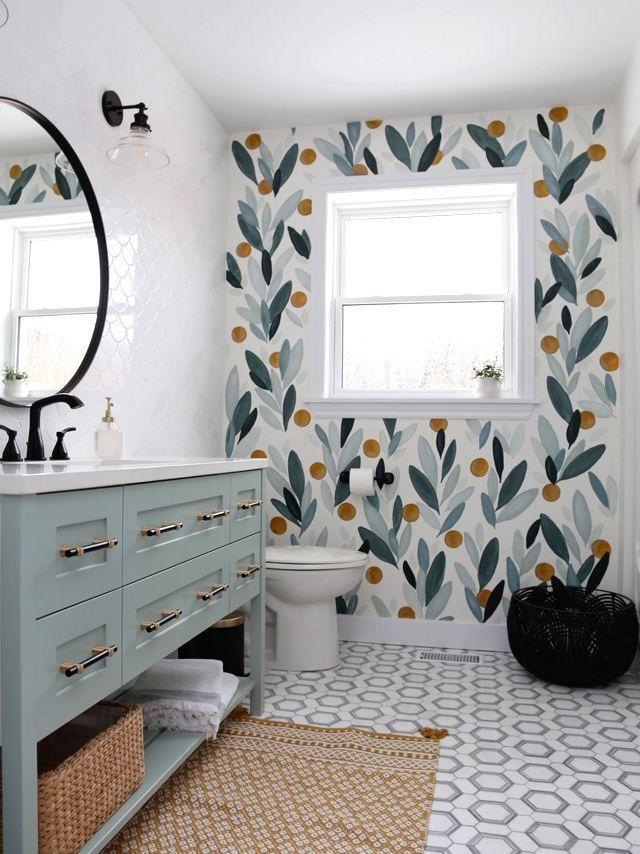 cute bath with wallpaper, tile, colorful vanity
