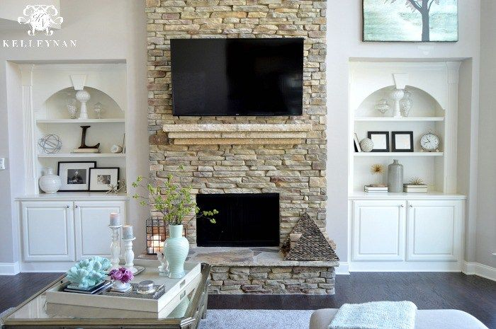 Two Story Living Room With Stacked Stone Fireplace And Built Ins