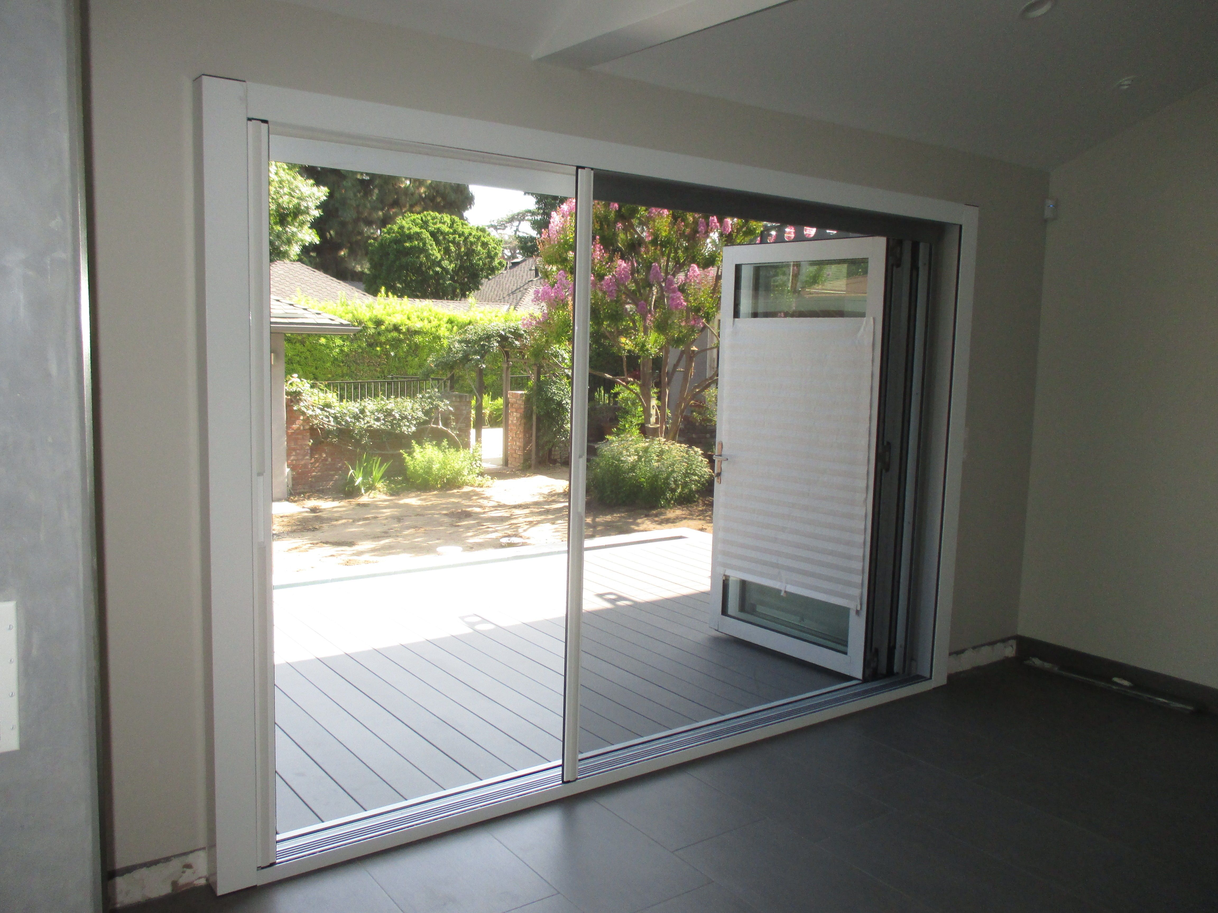 Our team did a unique installation of a double door Centor Screen with Black Super Screen on one side and White SheerWeave Blind for privacy on the other ... & Our team did a unique installation of a double door Centor Screen ...