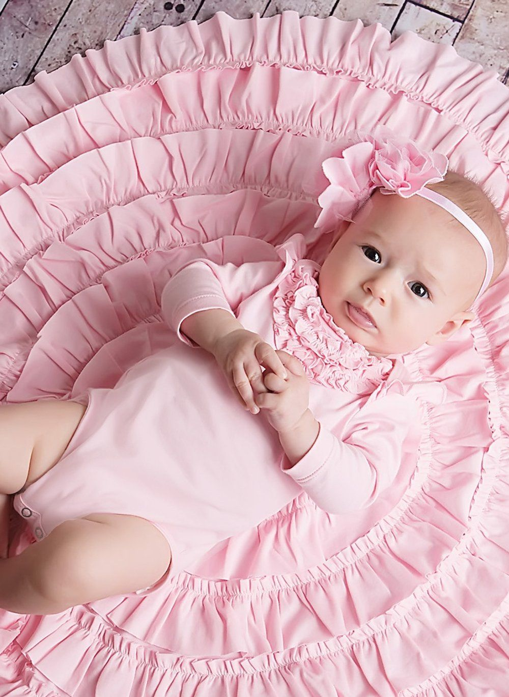 96be9d66ef7 Pretty ruffles vertically cover the front of this darling Lemon Loves  Layette Angel Gown in Rose Shadown. Made with luxurious soft pima cotton  for your ...
