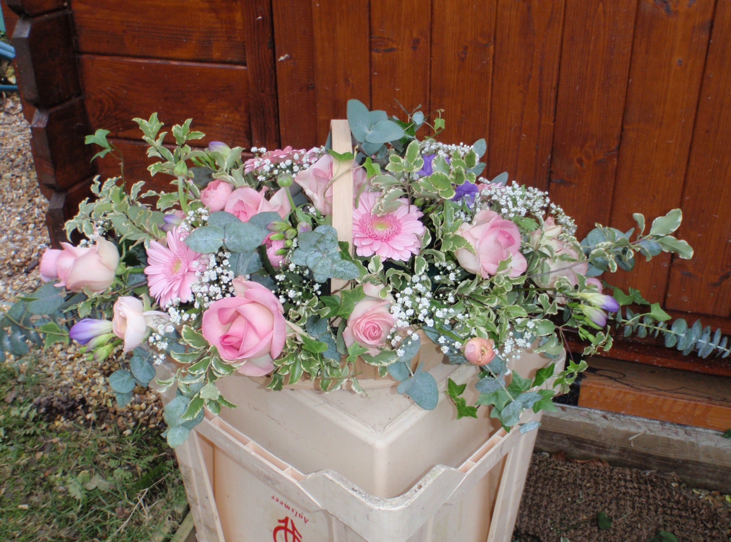 Trug Basket Using Pale Pink Flowers With A Touch Of Lilac Freesias Funeral Flowers Flowers Feed Pink Flowers