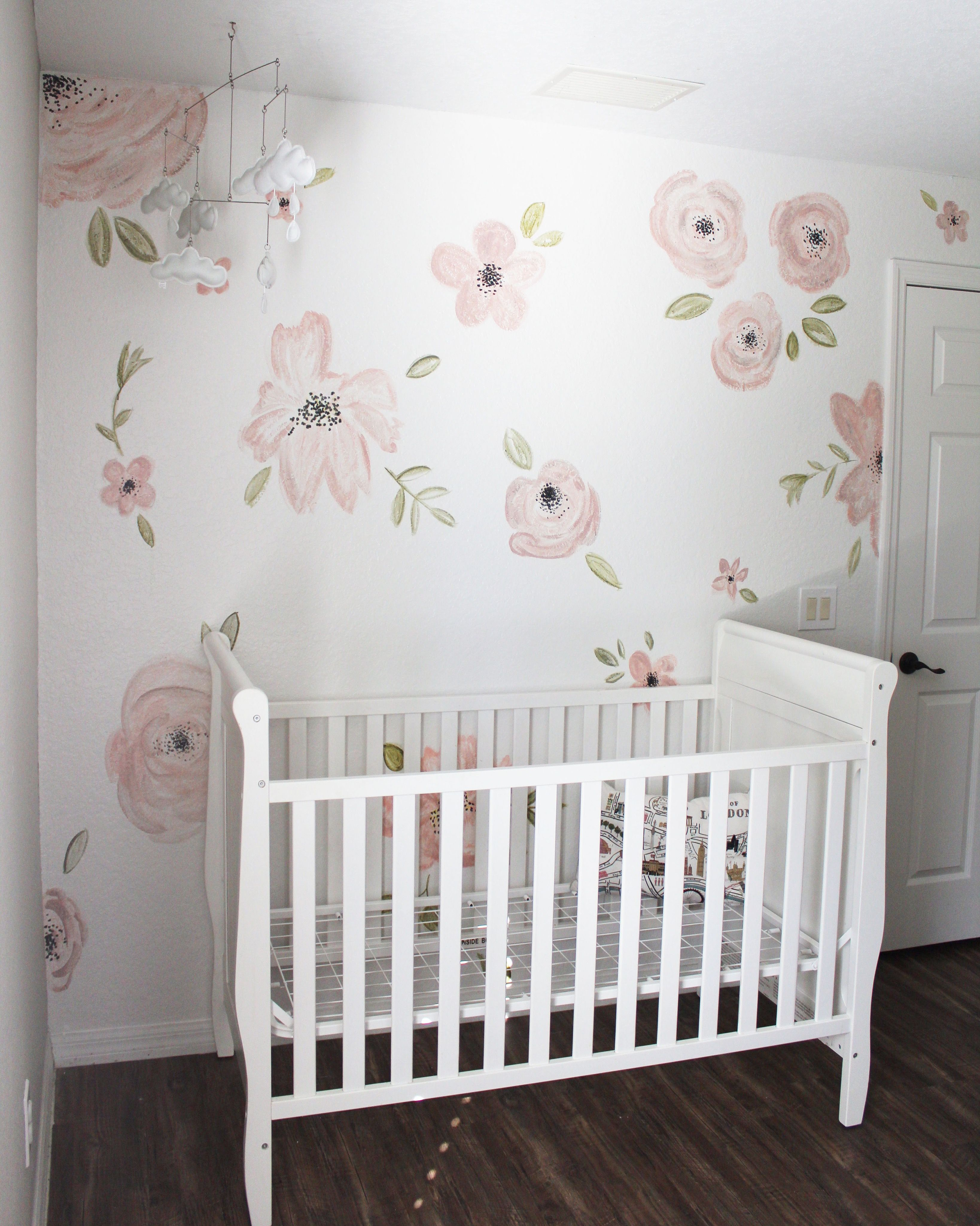 Hand painted accent wall for nursery! Floral nursery, pink