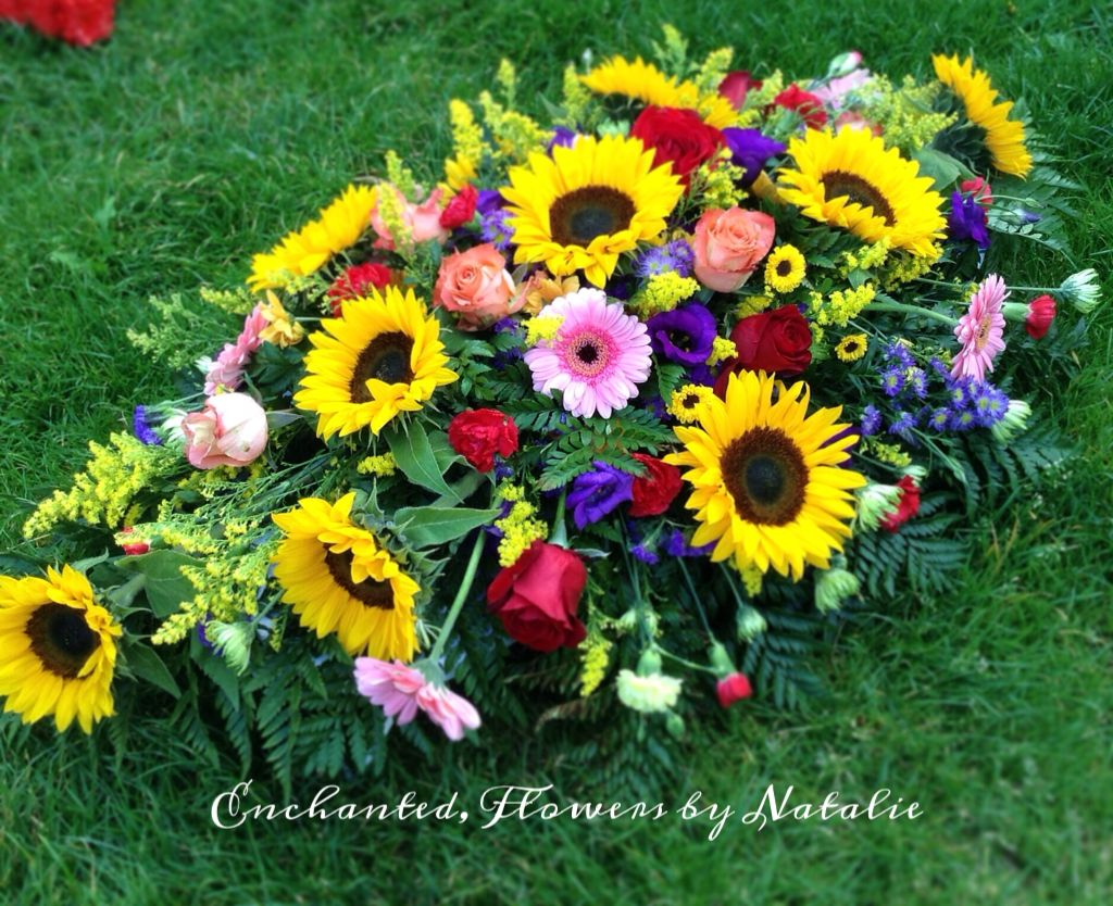 Bright vibrant funeral tribute flowers with