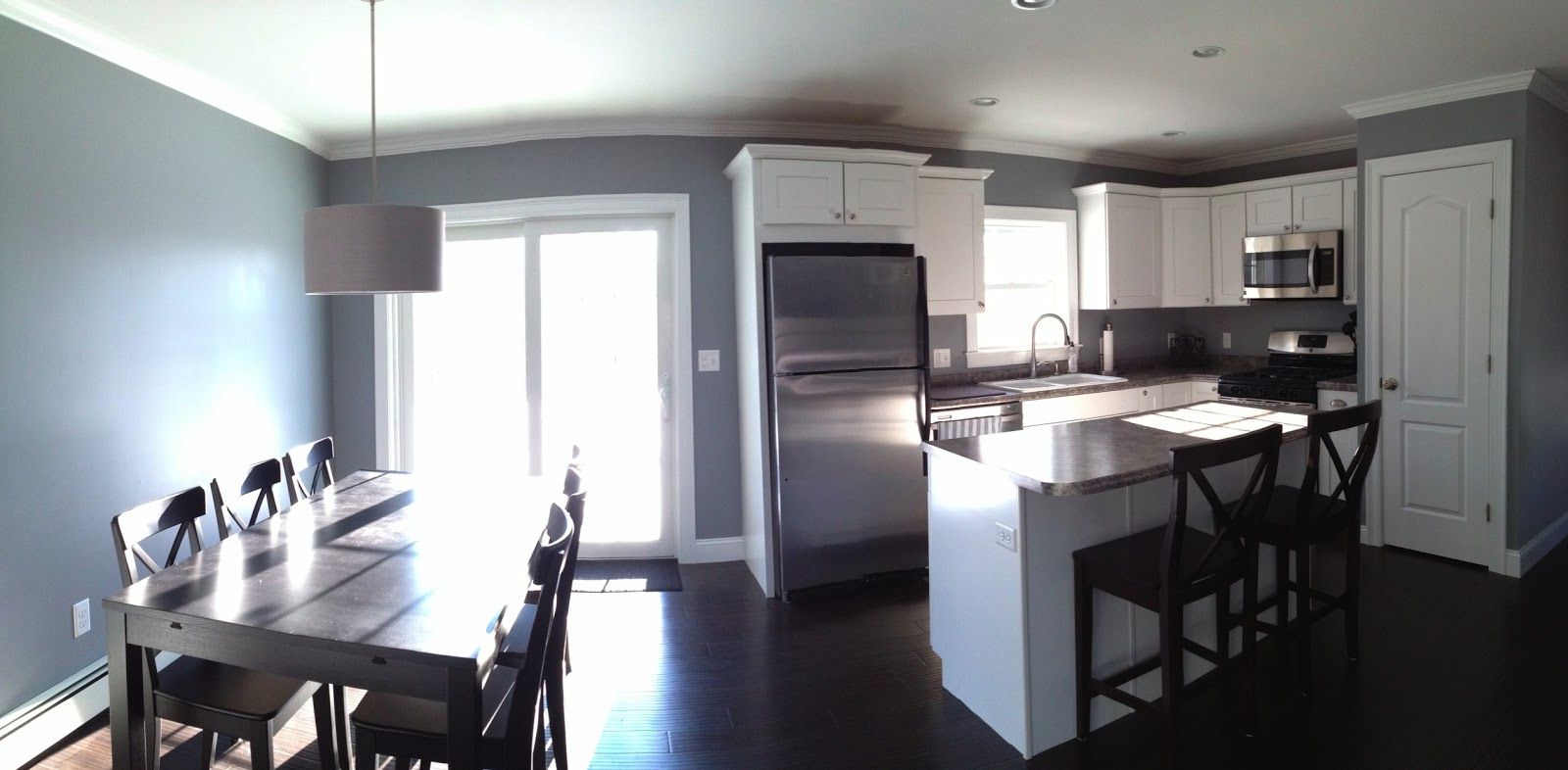 Open concept kitchen and dining room studio gray paint color drum shade light decor ideas - Paint colors for kitchen and living room ...
