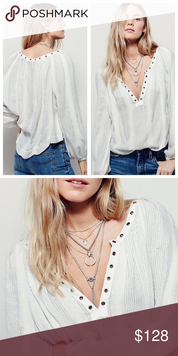 Free People against all odds top In an effortless, oversized fit this sheer blouse features metallic stripes, plunging V-neckline and metal grommet detailing. Long sleeves with elastic cuffs.  81% Rayon 19% Cotton Machine Wash Cold 🚫 No trades Free People Tops Blouses