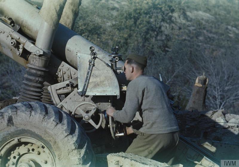 Gunner Kelford of Buckley Chester the gun layer at the 5.5 inch gun near Sessa Aurunca Garigliano River Valley Italy - 10th January 1944. [OS] [800x559]