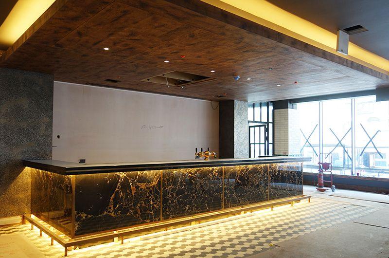 hexagonal monochrome tiles black and white tiles hotel interior design london bar - Traditional Hotel Interior