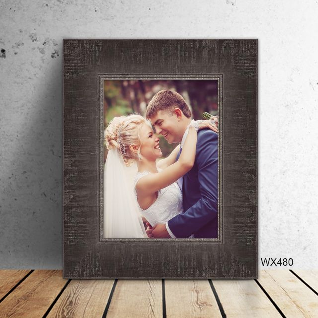 A black wood frame with sloped profile and visible wood ...