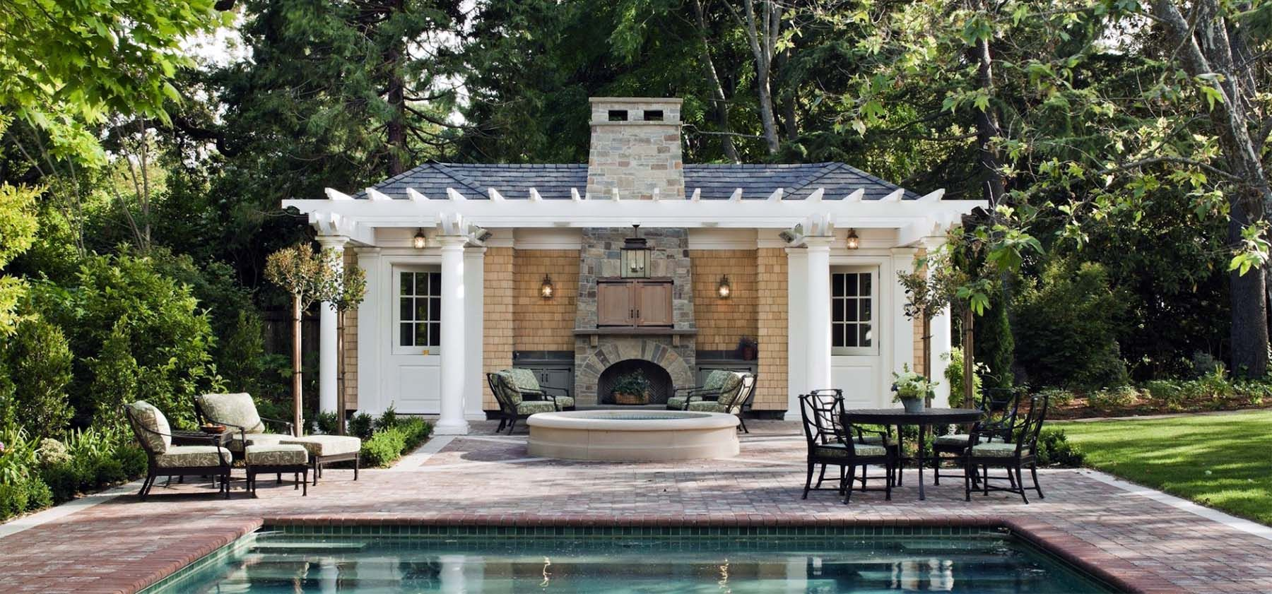 Small Pool House Design With Tan Cedar Shake Siding White Arbor Real Stone Outdoor Fireplace In 2020 Pool House Designs Guest House Plans Small Pool Houses