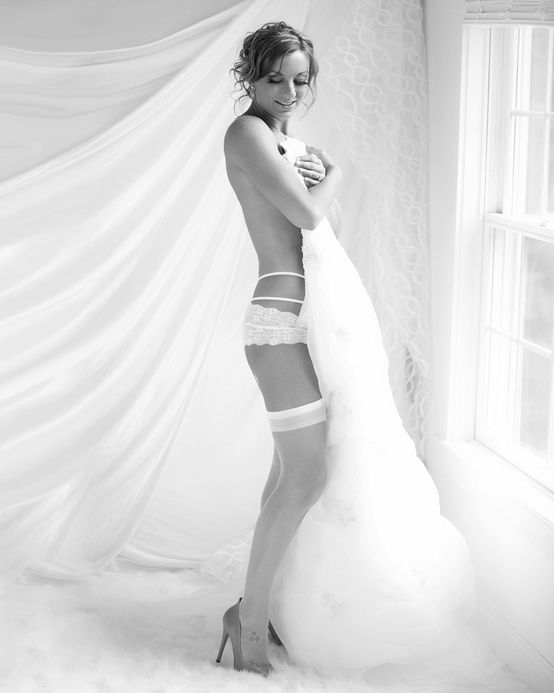 The hot new trend of Bridal Boudoir Photography is a way to show your pre-wedding bod and bridal lingerie, and to give your groom a keepsake of that body of yours to look back on twenty years and two kids later.