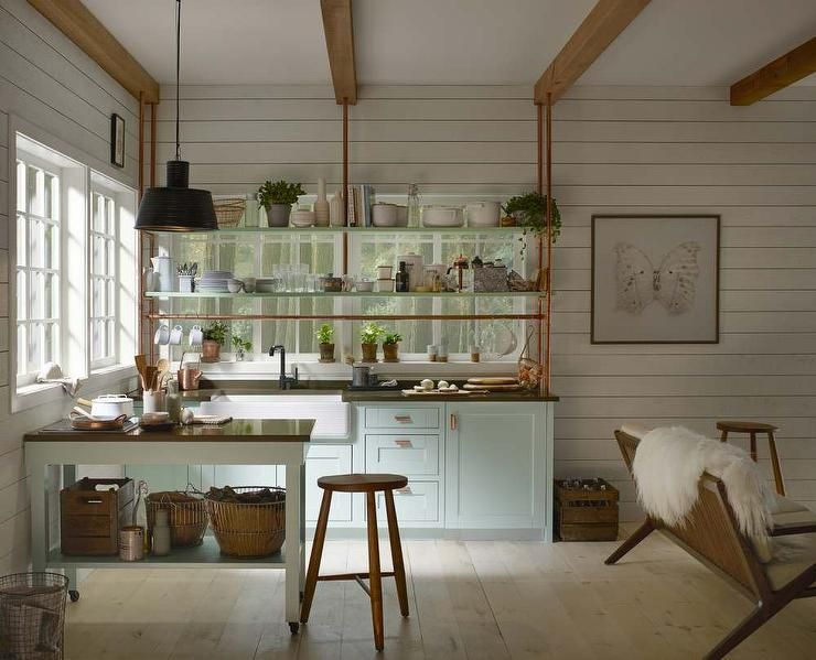 shiplap wall kitchen. small blue and white farmhouse kitchen boasts shiplap walls accented with wood ceiling beams wall