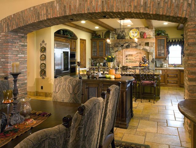 Love this archway idea for between the dining room and for Eldorado stone kitchen