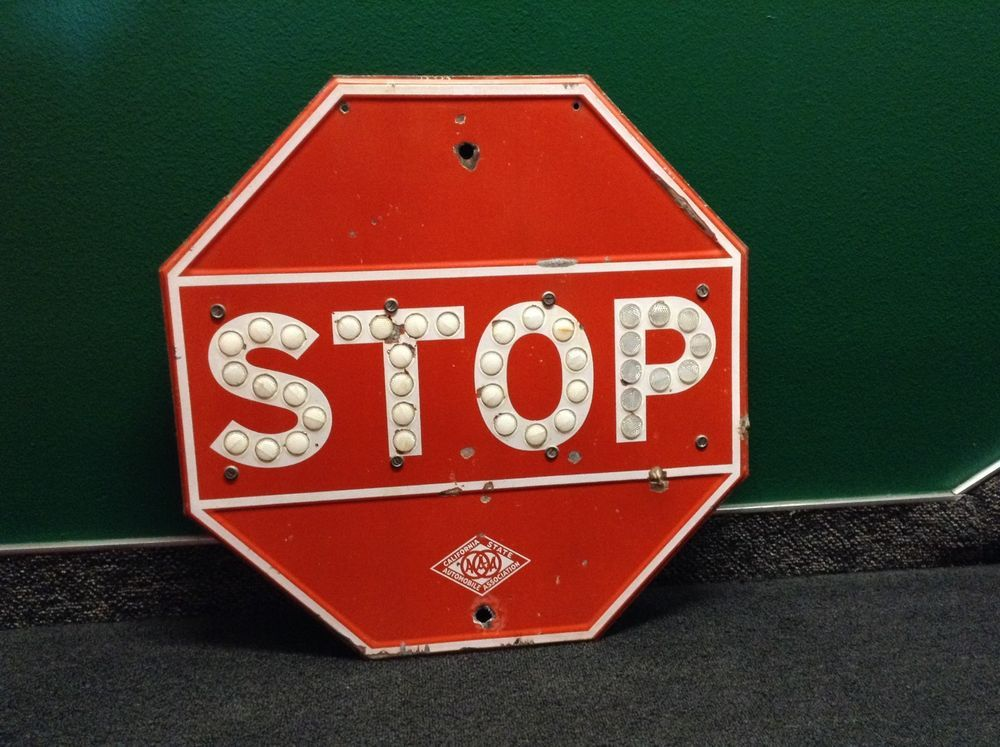 Red AAA STOP sign with CatEye Reflectors Advertising sign