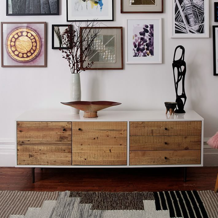 Town meets country on our Reclaimed Wood + Lacquer Media Console, framing rustic pine drawers in a modern lacquer frame. The wood comes from solid pine shipping pallets, reinvented into unique storage pieces for the home.