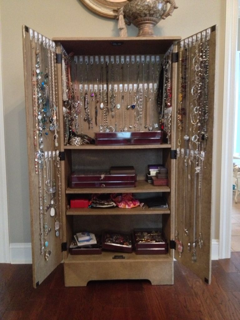 Cheap Media Cabinet And 90 Command Hooks Turned Jewelry Storage Armoire.