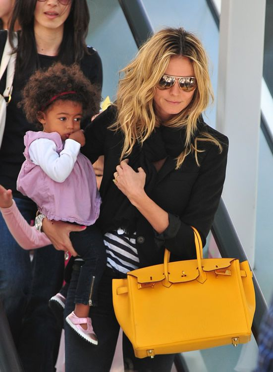 6dae1b25d35 Supermodel and supermom Heidi Klum doesn t shy away from making bold  fashion statements