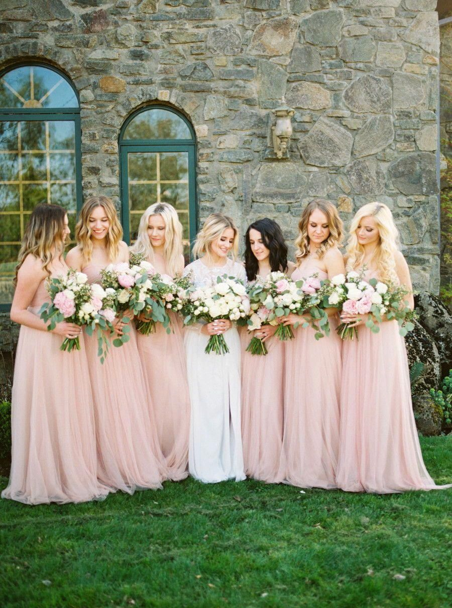 7b85d28d0b91c Jenny Yoo Bridesmaids, the long soft tulle Annabelle Dress in a shade of  blush / pink features a shirred strapless bodice with a sweetheart neckline.