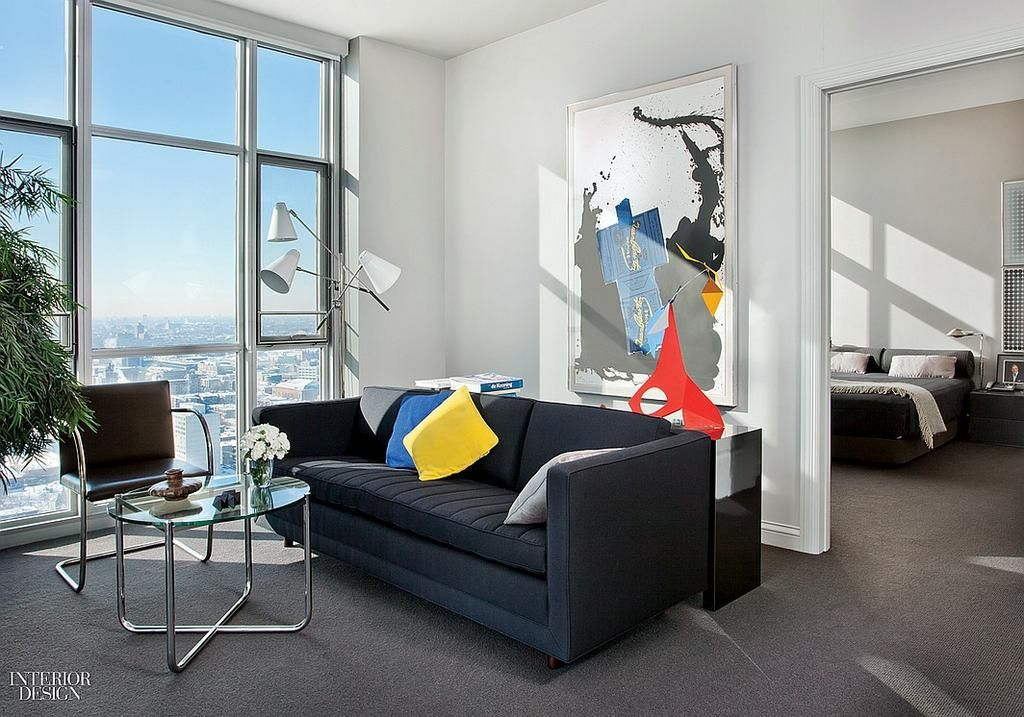 In this Chicago apt's living area, a custom sofa backs up to a Robert Motherwell lithograph: http://bit.ly/1wKvr4m