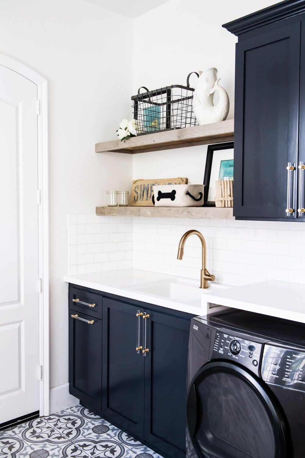 Navy Blue Cabinets And Pattern Tile Flooring In Modern Laundry
