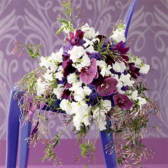 Purple and white wedding bouquet phalaenopsis orchid ranunculus purple and white wedding bouquet mightylinksfo