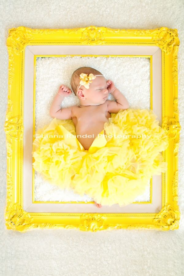 Lay an infant inside a picture frame, snap a shot.  Another cute sleeping-baby idea to do before they get wiggly and fussy. I love the Yellow!!  So Belle! Add a red rose bow in hair?