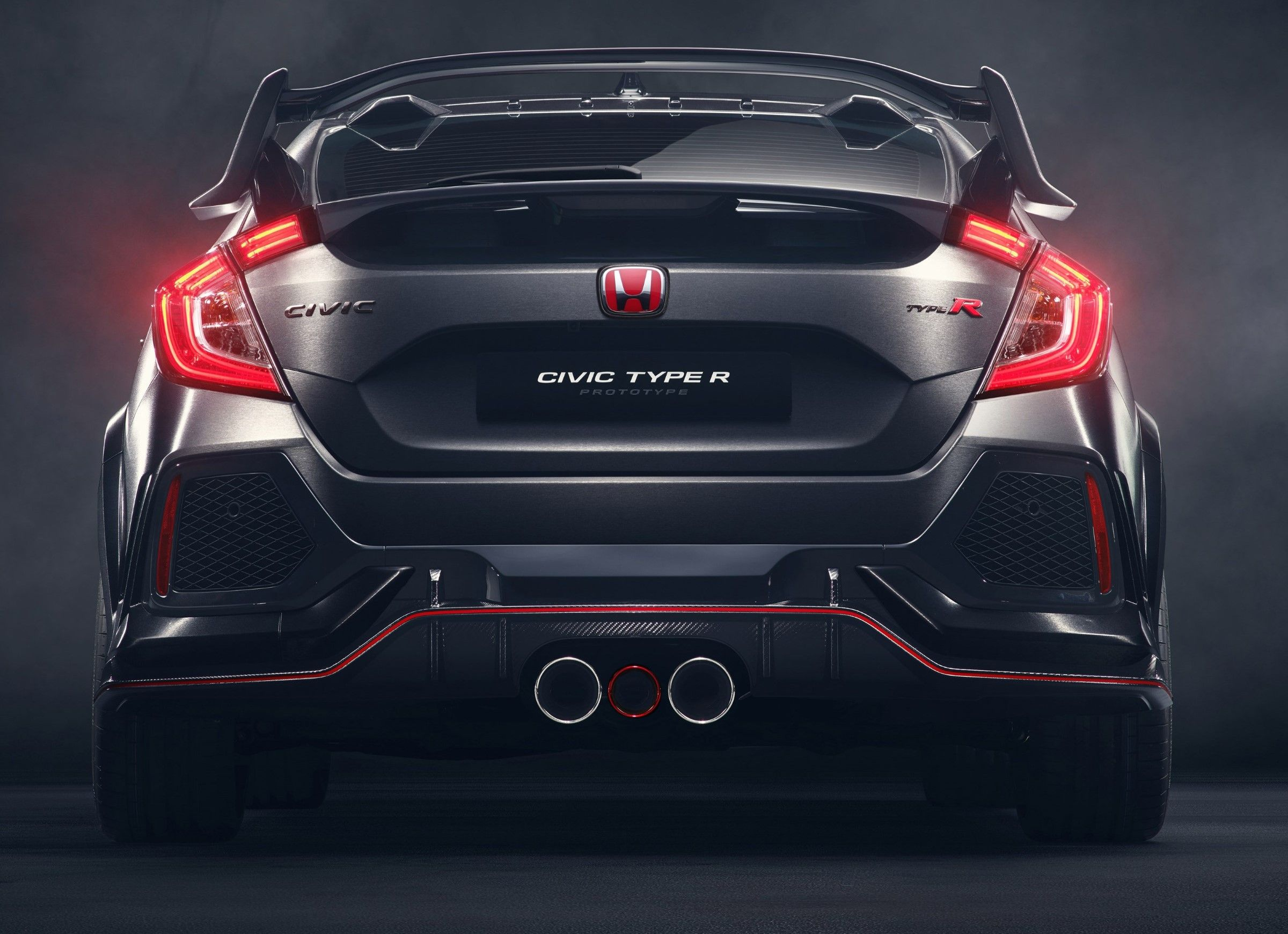 Joining the new honda civic hatchback in a world premiere at the paris auto show is the near production 2018 civic type r prototype and this one is coming