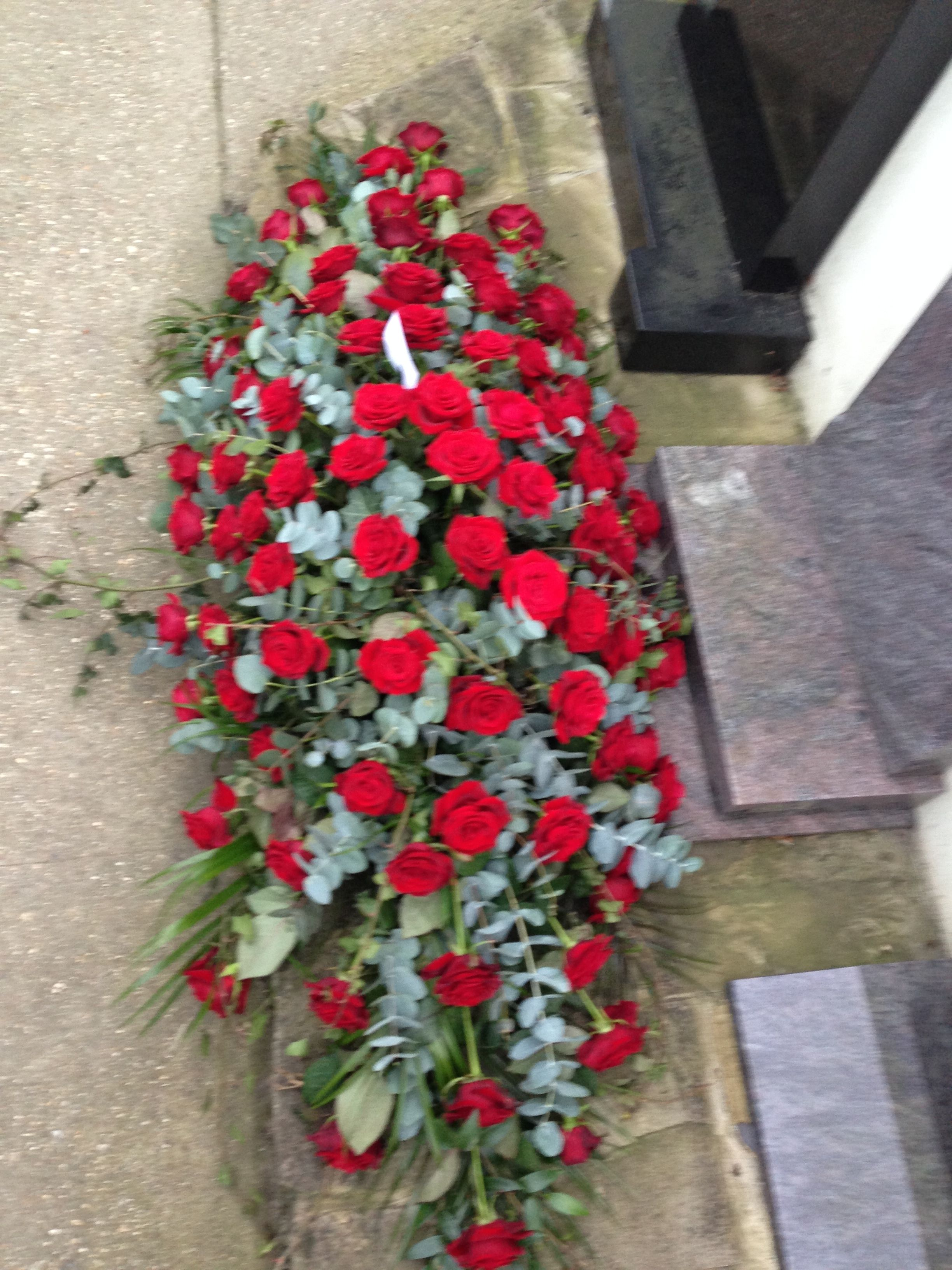 Funeral flowers red rose casket coffin spray www funeral flowers red rose casket coffin spray thefloralartstudio izmirmasajfo Image collections