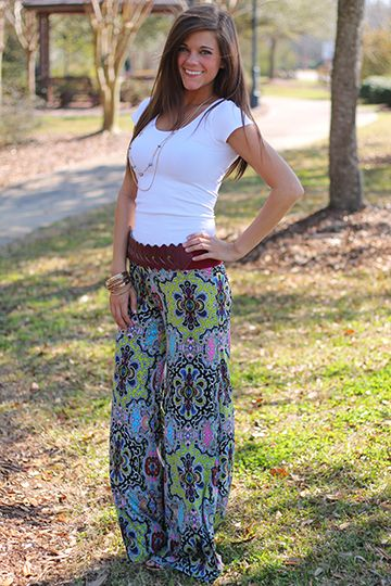 """We are dying over the patterns and bright colors in these pants! The wide legged pants trend is huge this season and this pair is super comfy and has a little stretch. Just add your favorite solid colored top and maybe even a belt... there's no wrong way to wear these! Fits true to size. Miranda is wearing a small.  From the waist  to the hem: All sizes-40"""""""