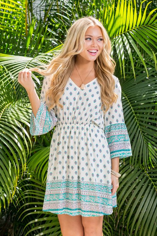 You'll be dreaming of this adorable dress for your next vacation or backyard party!