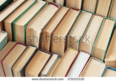 Many antique books in a book library. Book shop concept