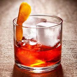 C & B Old Fashioned: Plymouth Gin, Lillet Blanc, Campari, Bénédictine, Cointreau, Club Soda, Orange Twist.