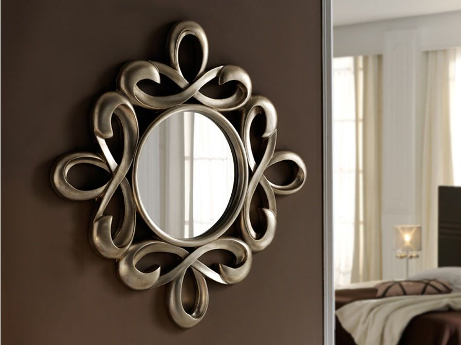espejo con marco moldeado acabado en pan de plata