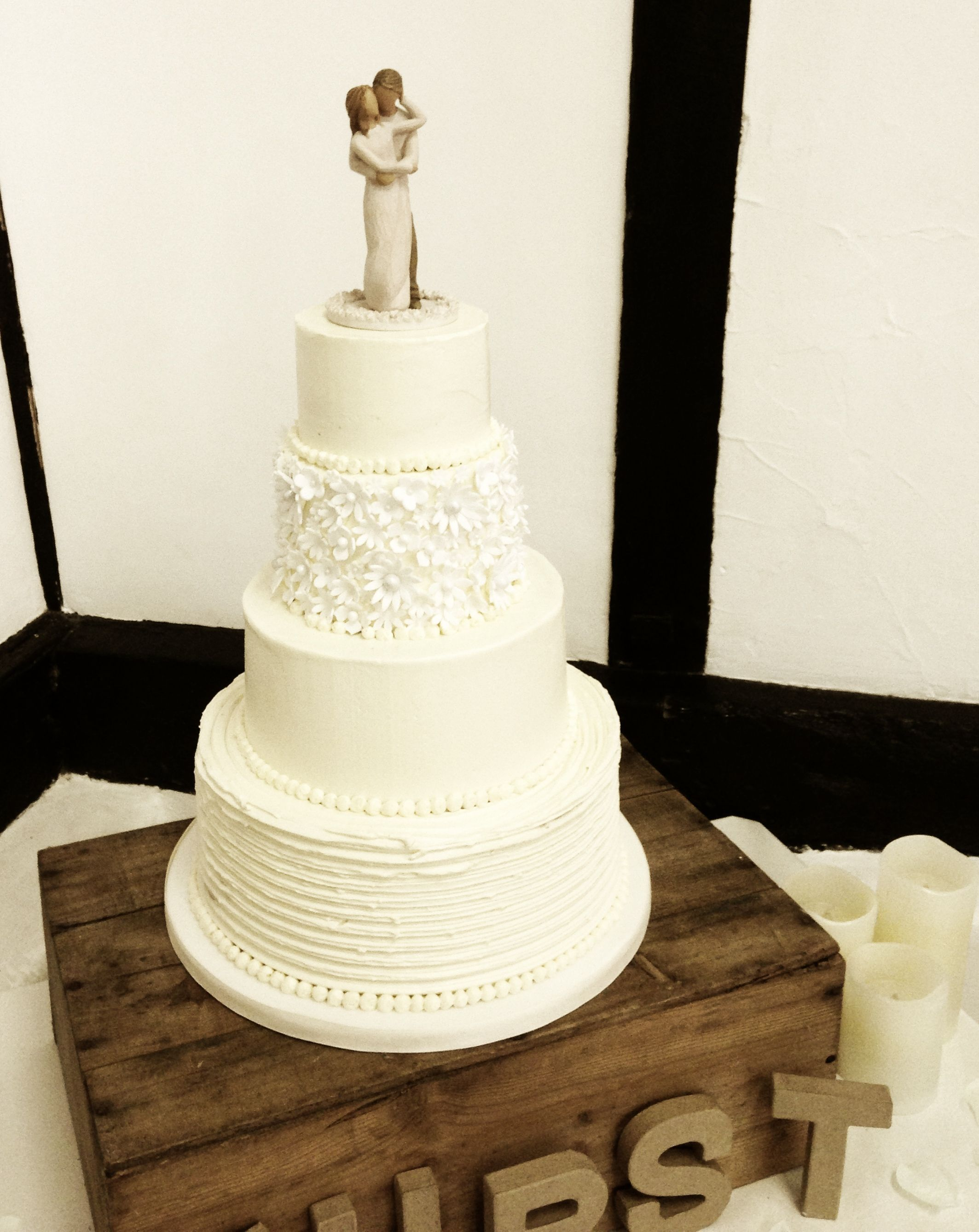 Rustic Wedding Cake With Willow Tree Topper Displayed On An Old Cider Crate By